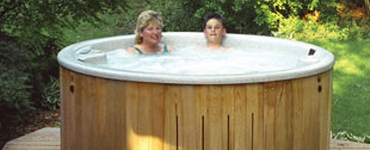 Mom and son in hot tub