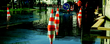 Safety cones in flooded street