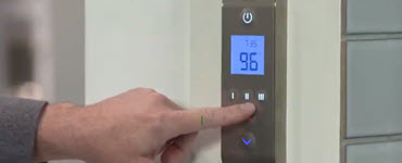 Finger pressing a shower technology panel