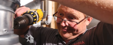 Man installing a water heater