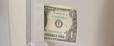 dollar bill in refrigerator door