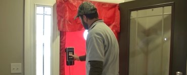 Energy rater performing analysis on a front door