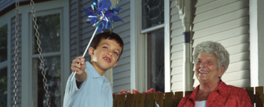 Boy and grandmother on front porch