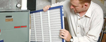 Man inserting an air filter