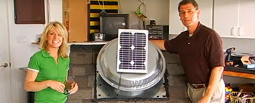 Megan and Pete standing next to solar attic fan