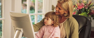 Mom and daughter on computer