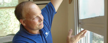 Home inspector checking a window